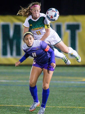 The University of Vermont's Brooke Jenkins, top, goes up for the ball over the University of Albany's Vivian Vega in Burlington on Thursday, October 12, 2017.