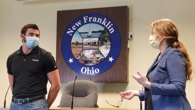 Summit County Councilwoman Bethany McKenny thanks New Franklin resident Doug Nist for his heroism during a New Franklin City Council meeting. On June 11, Nist jumped into the Tuscarawas River in Clinton and helped rescue a woman whose car went over an embankment and into the river.