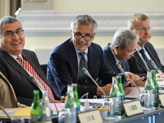 From left to right: The Vice-Presidents of the International Olympic Committee, IOC, Ugur Erdener,  Juan Antonio Samaranch Jr., Yu Zaiqing and John Coates wait for the opening of the IOC executive board meeting, in Lausanne, Switzerland, Switzerland, Sunday, July 9, 2017. (Jean-Christophe Bott/Keystone via AP)