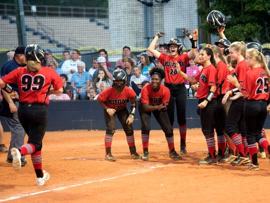 The West Florida Softball team gathers at the plate