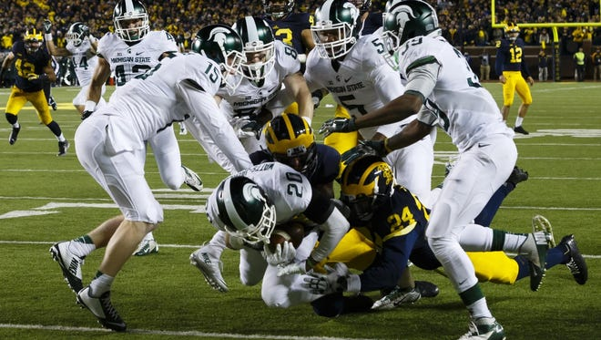 Michigan State wins on a muffed Michigan punt at the end of regulation.