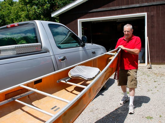 Norman Skinner, 79, a competitive canoe racer until recently, hardly has enough breath to carry his lightweight kevlar canoe to and from its perch in his garage. Skinner has suffered from serious breathing problems since his employment at a Simco Mine where he worked for 21 years. Skinner receives compensation from the federal government for his breathing problems.