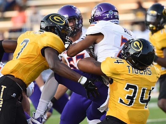 Grambling State linebacker Jeremy Carter (34) and defensive back Danquarian Fields (7) bring down a Northwestern State runner during a game at Eddie G. Robinson Memorial Stadium Sept. 9, 2017.