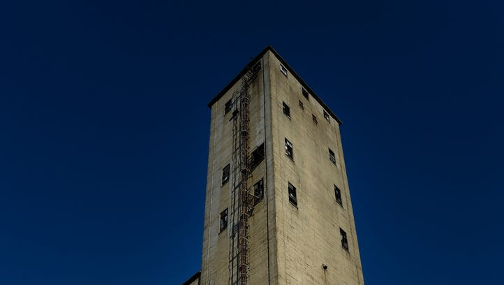 200-foot tall grain tower at the corner of 51st Avenue