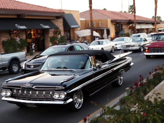 Vintage cars ease down El Paseo during the El Paseo