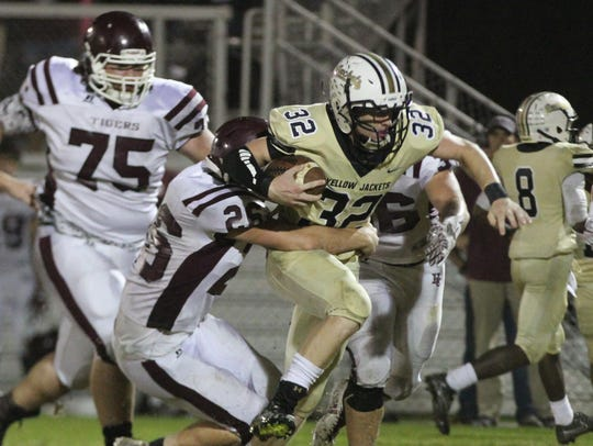Springfield's Bryan Hayes is tackled during the Yellow