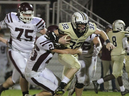 Springfield's Bryan Hayes is tackled during the Yellow Jackets' 20-10 win over Hardin County.