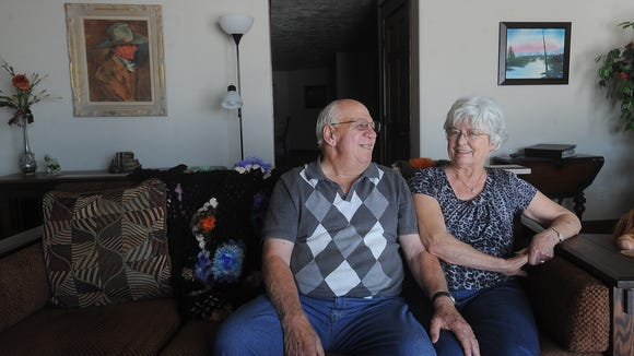 Duane and Marilyn Schreurs relax in their home near