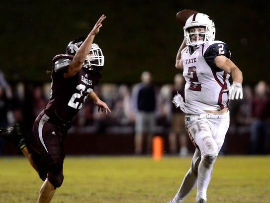 Tate High School quarterback Sawyer Smith sends the