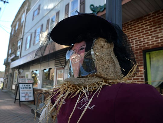A scarecrow of owner Rochelle Maul decorates a pole