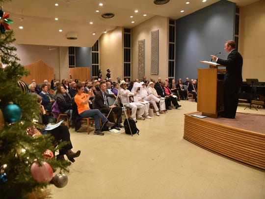 Elected official Josh Gottheimer speaks at a vigil for Sandy Hook massacre victims and Americans lost to gun violence at Central Unitarian Church in Paramus.