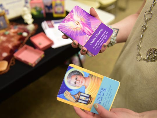 "Savannah Beard of Clyde uses cards to give what she calls ""angel readings."""