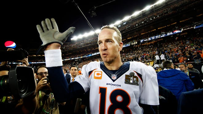 Peyton Manning #18 of the Denver Broncos celebrates after defeating the Carolina Panthers during Super Bowl 50 at Levi's Stadium on February 7, 2016 in Santa Clara, California. The Broncos defeated the Panthers 24-10.