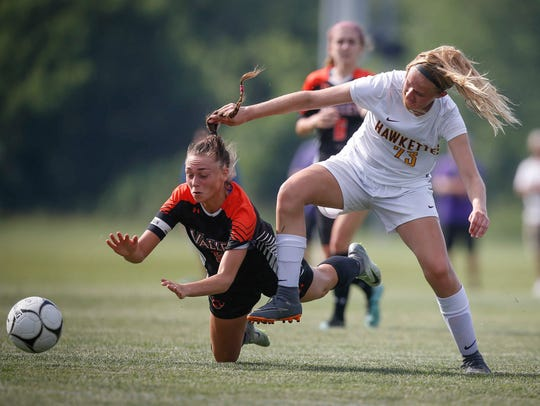 Ankeny's Saige Adamson, right, battles West Des Moines Valley's Libby Helversen for the ball during the Class 3A semifinals of the 2018 Iowa girls' high school state soccer tournament.