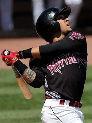 The Timber Rattlers' Isan Diaz follows through with a swing during their game against the Lake County Captains on Monday, July 25.