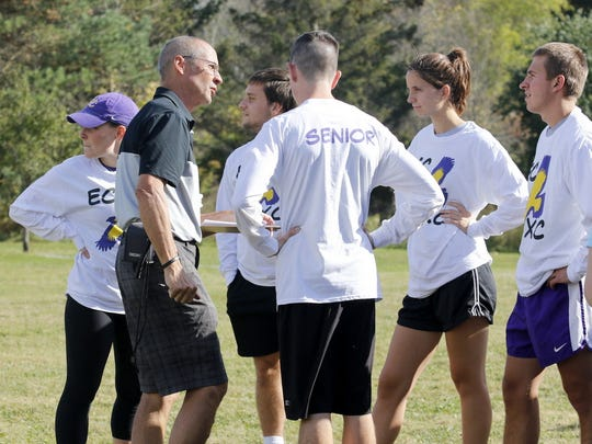 Corning cross country coach Lou Fiorillo talks to his runners during Elmira College Family Weekend on Oct. 7 at the Murray Athletic Center in Pine Valley.