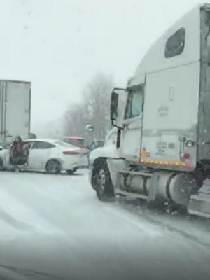 A screen capture shows the moment before a tractor-trailer hit a car on I-44.