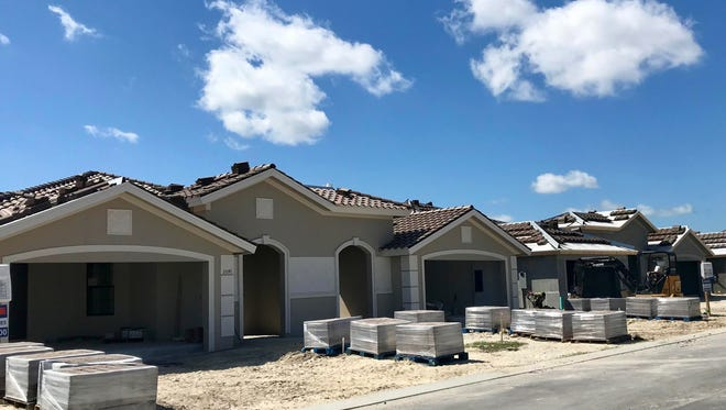 A mix of pre-sold homes and inventory homes are under construction at Zuckerman Homes' Venetian Pointe community in South Fort Myers.