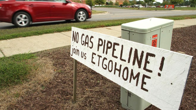 A hand-lettered sign on M-36 in Putnam Township protests the proposed Energy Transfer Rover pipeline, which federal regulators approved last month