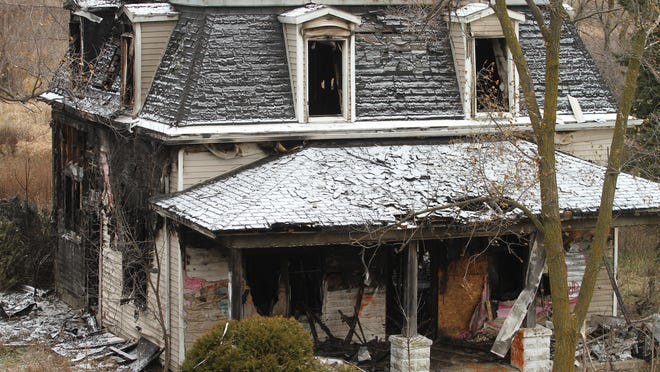 This house was damaged by fire Sunday evening, The building faces M-59 near a railroad spur just east of Byron Road in Howell Twp.