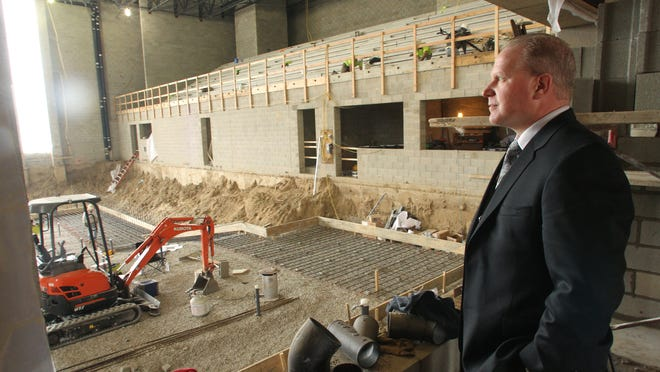 Gregory B. Gray, Brighton Area Schools superintendent, views the interior of the new high school pool facility currently under construction.