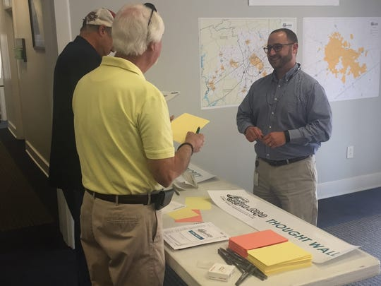 A GPATS representative, right, talks with Easley residents during a public input gathering session at City Hall.