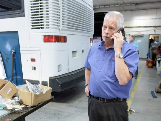 Bailey Coach Trailways owner John Bailey takes a call while in the planning stages of sending three coaches to Texas on Monday, Aug. 28, 2017. Earlier in the day, FEMA contacted the business to see if it could help with transportation during the Texas flooding. Bill Kalina photo