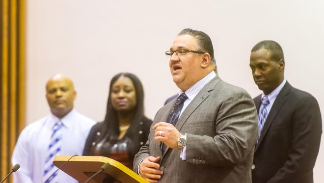 Vineland Mayor Anthony Fanucci, encompassed by fellow elected officials, speaks during Demetrica Todd-Ruiz's swearing-in as Judge of the Municipal Court of Vineland at Vineland City Hall on Thursday, January 26.