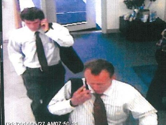 Two men wanted for questioning by South Burlington Police walk through the lobby of Vermont Gas on May 27 in this surveillance camera image.