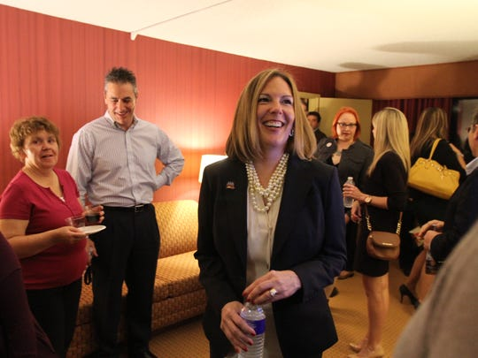 Sandra Doorley chats with supporters and visitors to her suite before winning a second term as Monroe County district attorney.