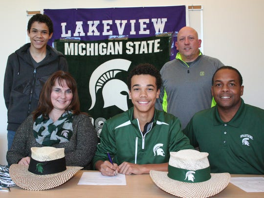 Lakeview's Andrew Walker has signed to play golf at Michigan State University as he is joined by his parents Nancy and Filmore Walker along with his brother Darius and Lakeview coach Tony Evans.