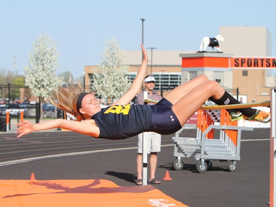 Hartland's Lindsey Strutz set the school record in the high jump with a leap of 5-3.75 in the Larry Steeb Memorial Meet of Champions in Dexter.