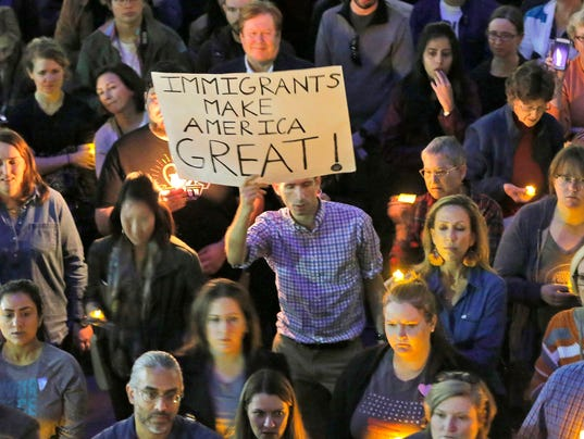 Hundreds protest Trump travel ban at Dallas vigil