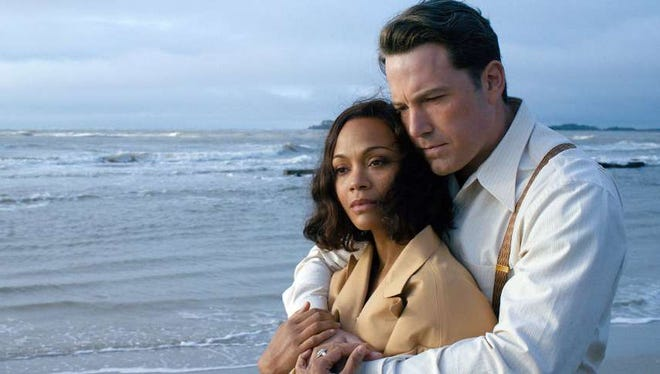 "Gangsters need love, too: Zoe Saldana and Ben Affleck in ""Live by Night."""