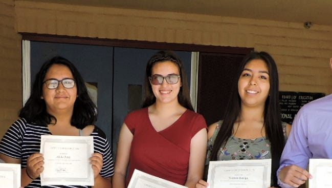 Deming High School students who participated in the Youth Council's Summer Leadership Camp display their certificates. From left are Meghan Flores, Robert Devine, Alicia Peña, Shannah Rudiger, Yasmín Zuniga, Pryank Patel and instructor, Grace Flores.