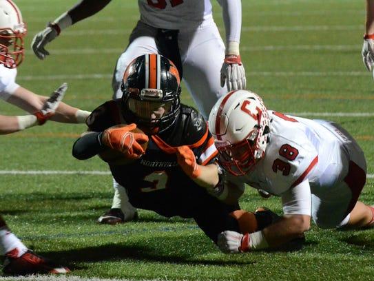 Northville's Zach Prystash dives for a touchdown score