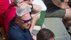 Race fans try to stay cool before the start of the
