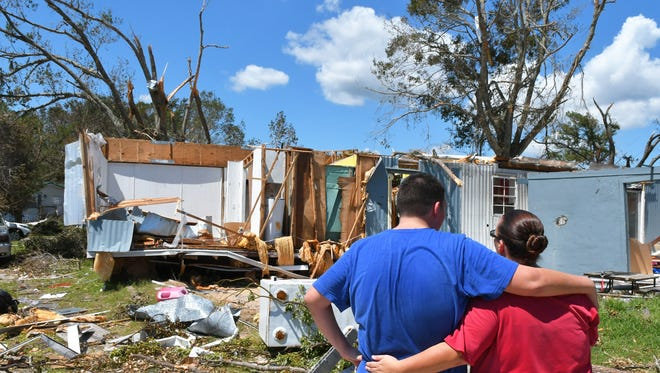 13 year old David, Jr. comforts his mother, after the family of 7 had their manufactured home in Mims destroyed from a tornado spawned by Hurricane Irma.