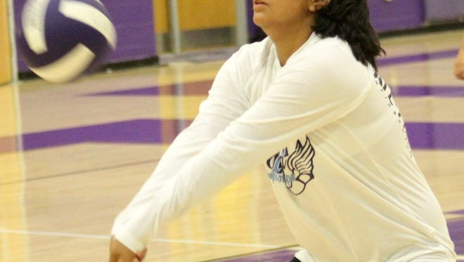 Mescalero freshman Madisyn Yuzos digs a ball during workouts Wednesday evening.