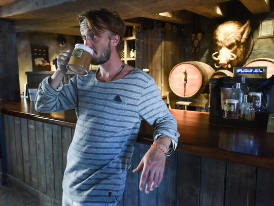 Tom Felton downs a Butterbeer at Three Broomsticks.