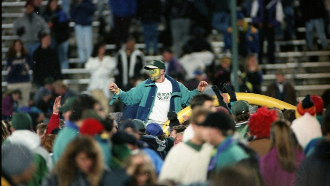 Colorado State University football fans tear down the goalpost at Hughes Stadium during their celebration after the Rams beat Wyoming in the 1994 Border War game.