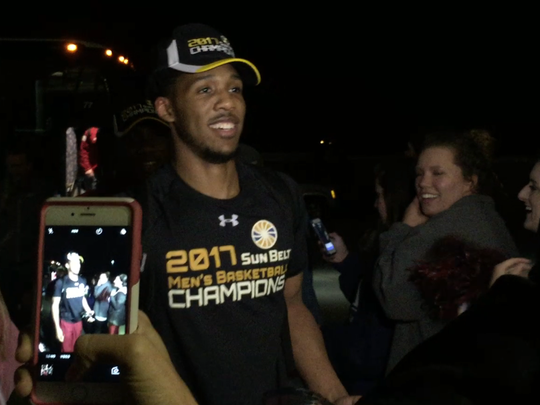 Wesley Person and the Troy Trojans were greeted by about 50 fans when they returned home at almost midnight Sunday after winning the Sun Belt Tournament.