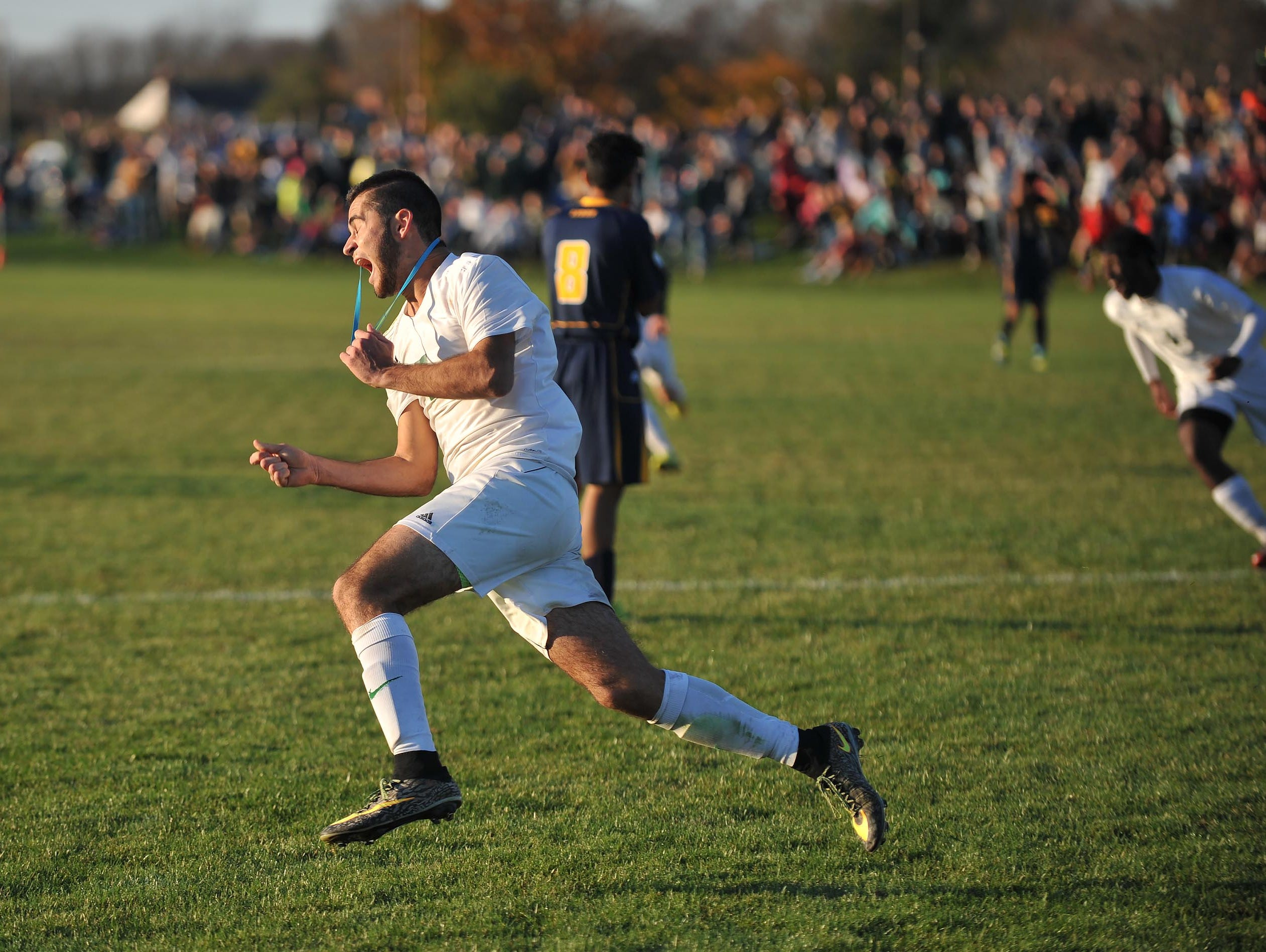 Schalick's Michael D'Orio (7) reacts after scoring the winning goal over Lindenwold, in overtime, Friday, Nov. 13 in Pittsgrove.