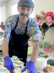 Cook Larry Jobe serves up cake for the grand-reopening