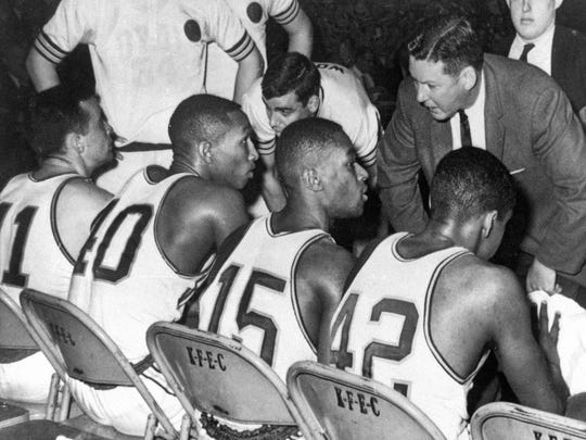 Loyola-Chicago coach George Ireland, right, talks to John Egan, from left, Vic Rouse, Jerry Harkness and Ron Miller in Louisville in 1963.