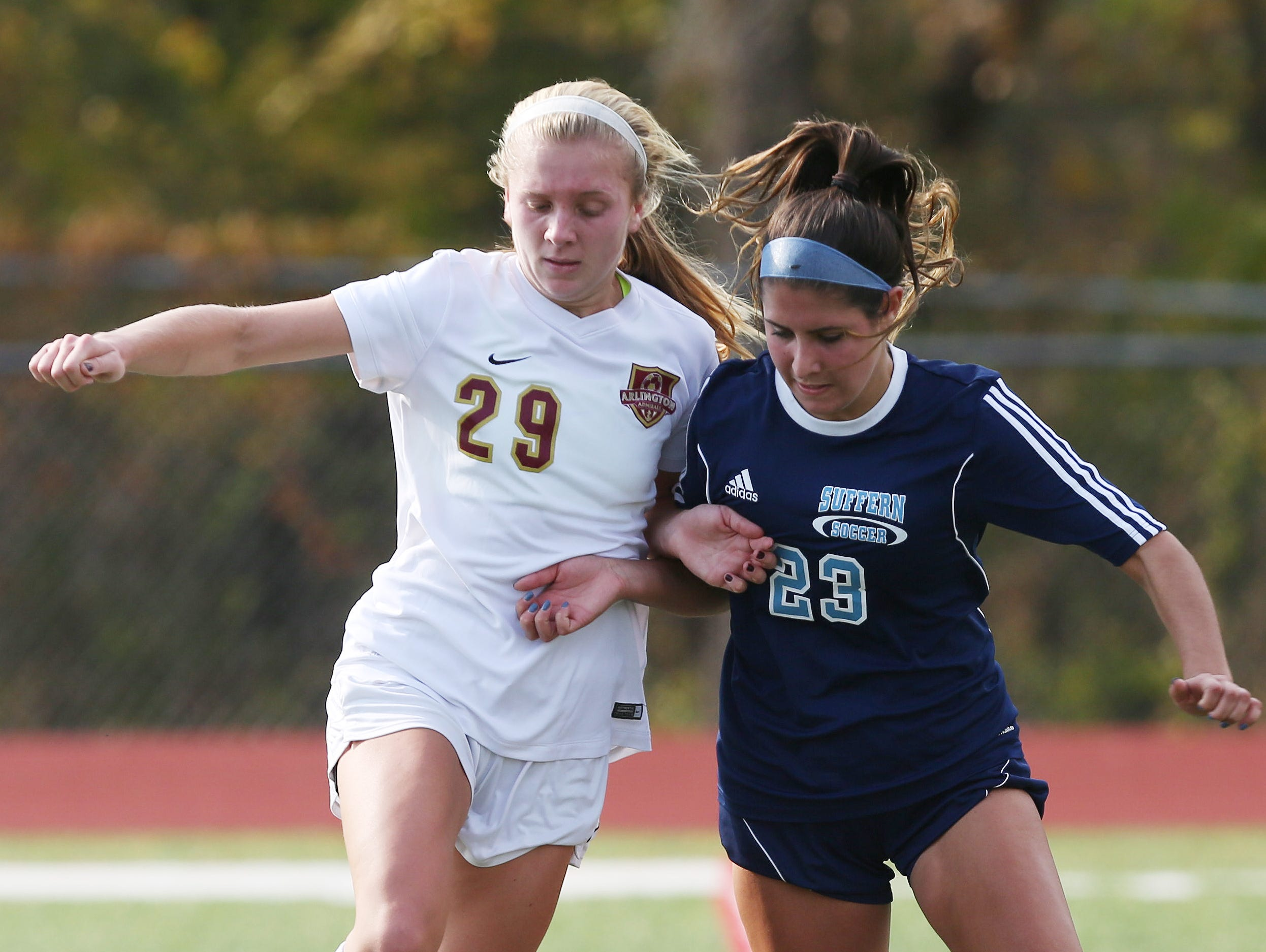 From left, Arlington's Molly Feign (29) and Suffern's Jackie Santangelo (23) battle for ball control during the girls soccer Section 1 Class AA championship game at Yorktown High School Oct. 30, 2016. Arlington won the game 2-0.