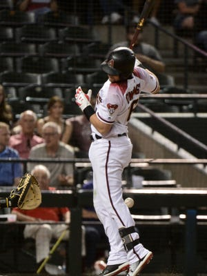 Jun 11, 2018: Arizona Diamondbacks center fielder Chris Owings (16) is hit by a pitch in the seventh inning against the Pittsburgh Pirates at Chase Field.