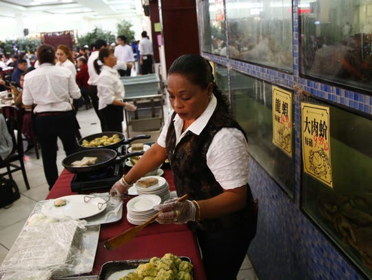 Fresh-prepared dishes are made in front of the living