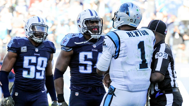 Titans linebackers Wesley Woodyard (59) and Avery Williamson (54) take issue with Panthers quarterback Cam Newton's celebration dance after his touchdown during the fourth quarter.