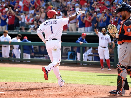 Texas Rangers' Elvis Andrus (1) acknowledges the crowd after hitting a solo home run off of Houston Astros starting pitcher Lance McCullers Jr. in the third inning of a baseball game, Saturday, March 31, 2018, in Arlington, Texas. (AP Photo/Jeffrey McWhorter)